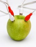 Green power. A green apple with audio or power connections coming out of it stock photos