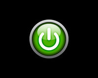 Green Power button on black background Stock Photography