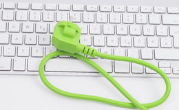 Green power cord on keyboard stock photography