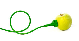 Green power cord plugged into apple outlet. Against white background royalty free stock images