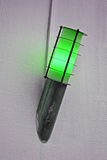 Green power lamp on the wall, energy details, Royalty Free Stock Photography