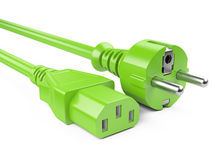 Green power plug and electric cables. Eco concept Royalty Free Stock Images