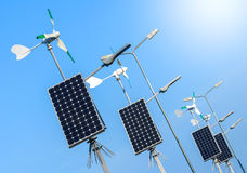 Green power, wind turbines and solar panels. Royalty Free Stock Photography