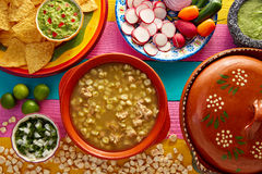 Green Pozole verde with blanco mote corn. And ingredients on colorful table Royalty Free Stock Photography