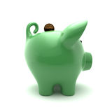 Green ppiggy. Green piggy side view on a background Stock Photo