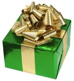 Green present. Gift box with green foil paper and golden metalic ribbon royalty free stock image