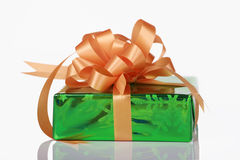 Green present with orange bow Royalty Free Stock Photography