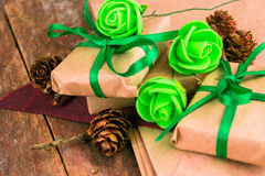 Green presents wrapped in natural paper on old wood stock photography