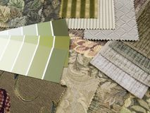 Green print interior decoration plan. Earthy green paint color swatches with upholstery textile samples Stock Photography