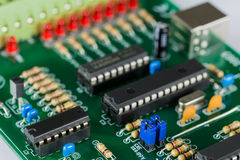 A green printed circuit board. With electronic components Royalty Free Stock Photography