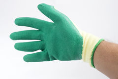 Green protective gloves Royalty Free Stock Image