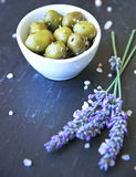 Green Provencal olives on a black slice Royalty Free Stock Images
