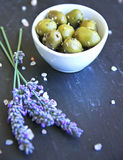 Green Provencal olives on a black slice Royalty Free Stock Image