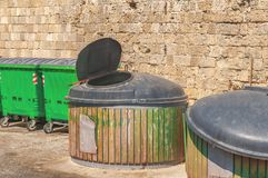 Green public garbage trash container at street with open coverlid. Waste Stock Images