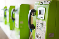 Green public telephone booth in the hospital. Stock Image