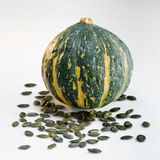 Green pumpkin and seeds Royalty Free Stock Photo