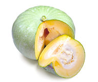 Green pumpkin and slices Royalty Free Stock Photography