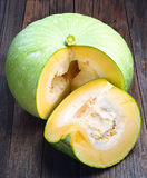 Green pumpkin and slices Royalty Free Stock Image