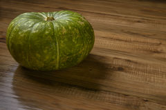 Green Pumpkin on Wood Table, Concept and Idea of Food Rustic Style. Stock Images