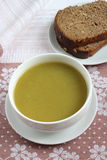 Green Pureed Soup and brown Bread. On the table Royalty Free Stock Photo