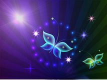 Green, purple and blue shiny background with transparent butterflies. Glowing background with magic  butterflies and sparkling stars.Transparent butterfly and Stock Photo