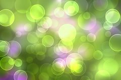 Green and purple bokeh background Royalty Free Stock Photo