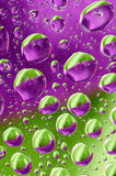Green and purple droplets Royalty Free Stock Photos
