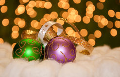 Green and purple gold Christmas ball ornaments Stock Photography