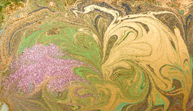 Green, purple and golden liquid texture. Hand drawn marbling background. Ink marble abstract pattern Royalty Free Stock Photography
