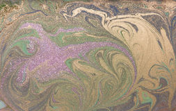 Green, purple and golden liquid texture. Hand drawn marbling background. Ink marble abstract pattern Royalty Free Stock Image