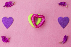 Green and purple hearts Stock Photos