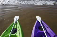 Green and Purple Kayaks on Beach Royalty Free Stock Image