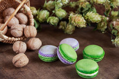 Green and purple macaroons. Rustic scene Stock Photo