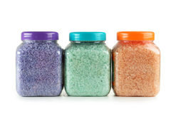 Green, purple, orange sea salt in bottles isolated on a white Royalty Free Stock Images