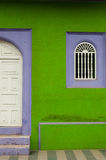 Green and purple stone wall of colonial house with Royalty Free Stock Image