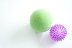 Green and Purple Stress Balls Stock Photo