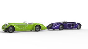Green and purple vintage cars. Back to back Royalty Free Stock Photography