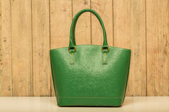 Green purse on wood background Stock Photos