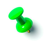 Green pushpin. On a white background Royalty Free Stock Photo