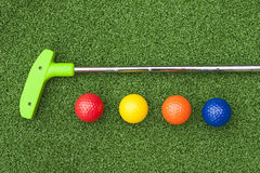 Green Putt Putt Club With Balls Stock Image