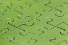 Green puzzle background. Greenery color Royalty Free Stock Images