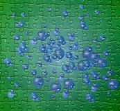 Green puzzle pattern with blue bubbles. Abstract illustration with blue bubbles on green puzzle texture Royalty Free Stock Images