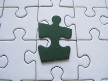 Green puzzle piece. Green jigsaw piece on a puzzle background royalty free illustration