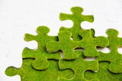 Green puzzle piece Royalty Free Stock Images