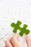 Green puzzle piece Stock Photos