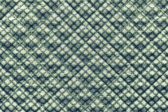 Green quilted fabric with a pattern from crosses Stock Photos