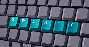 Green qwerty button on keyboard. Close-up royalty free stock photography