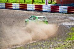 Green Racing Car. Car taken a curve with skid Royalty Free Stock Photos
