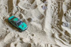 Green racing car on the track. Goes through the sand Royalty Free Stock Image