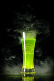 Green radioactive alcohol with biohazard. Symbol inside, isolated on black background Royalty Free Stock Photos
